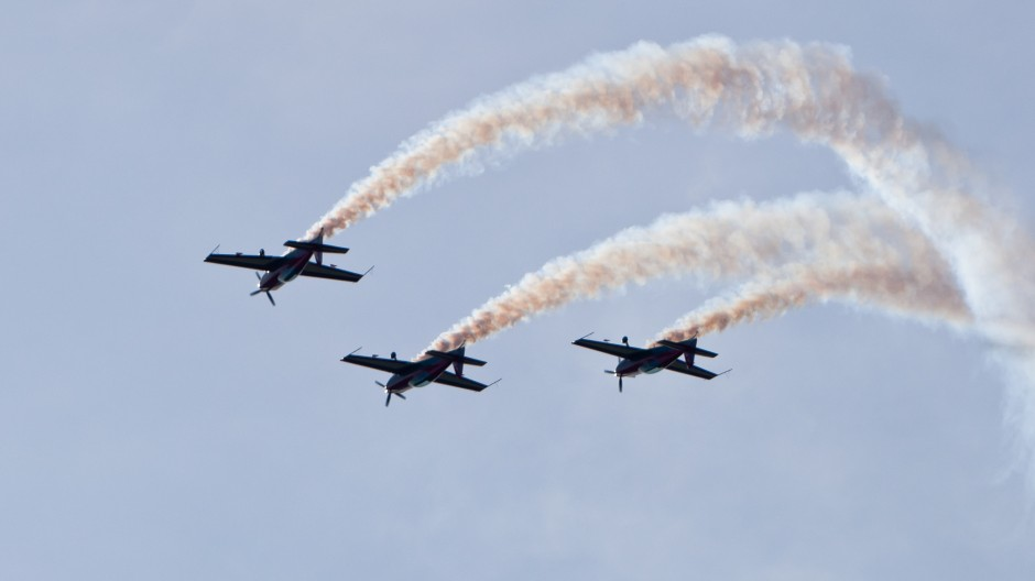 Royal Jordanian Falcons formation flight, Extra EA-300L at OTT11